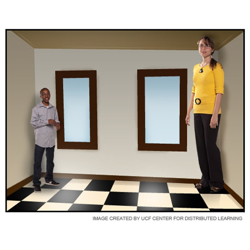 Photo of two individuals standing in a room